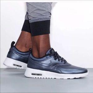 Metallic Grey Nike Thea
